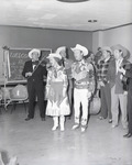 Roy Rogers and Dale Evans with band, 1957