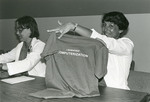 """Priscilla James and Roxanne McClive (w/ """"I survived computerization"""" T shirt), 1985 by Medical Graphics and Communications"""